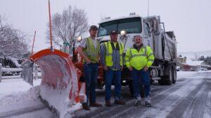 snow plow and crew